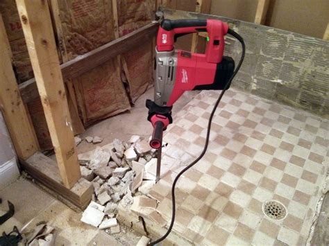 hammer drill makes removing shower pan much easier