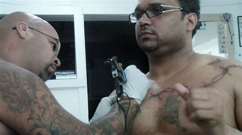 dagos tattoo being tattooed on the chest and back at dago s