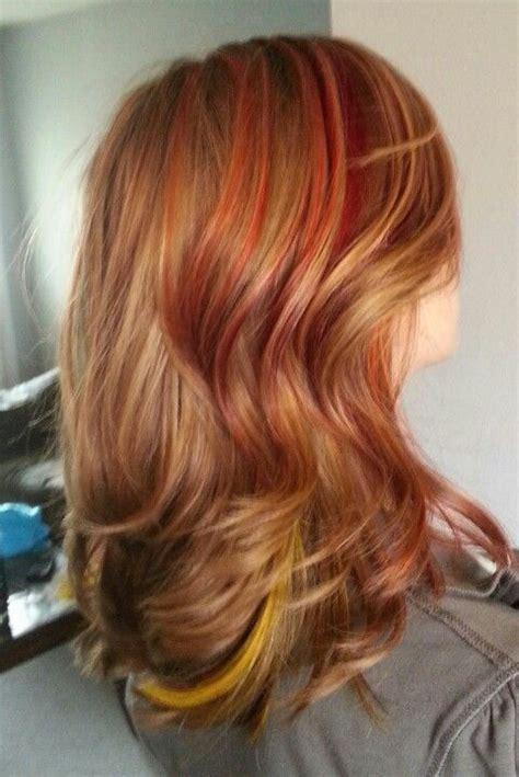 hairstyles with orange highlights sunrise streaks red pink orange yellow highlights hair