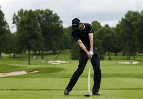 right leg straightening in golf swing swing sequence jimmy walker photos golf digest