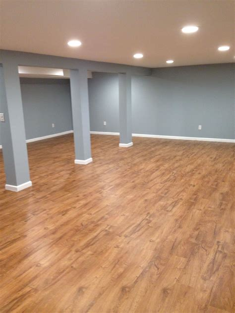 Laminate Flooring In Basement Our Basement With Resort Teak By Shaw Laminate Flooring Completed Basement