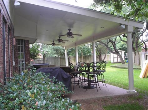 sleek patio cover with fans and lights outside