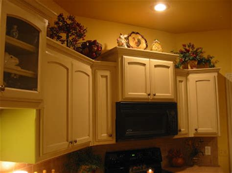 kitchen cabinet top decor decorating ideas for the top of kitchen cabinets pictures