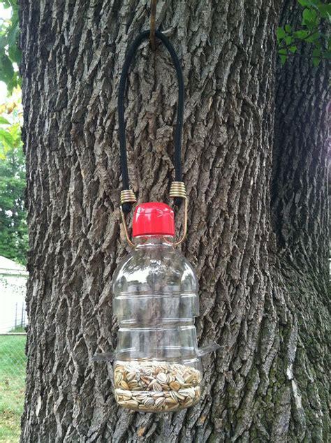 my diy bird squirrel feeder it s just a creamer container