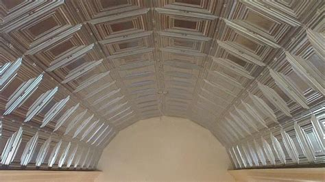 pressed plate tin metal ceiling installation on a barrel
