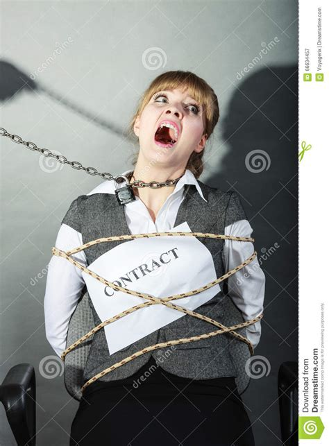 Chair Bound by Upset Businesswoman Bound By Contract Terms Stock Photo