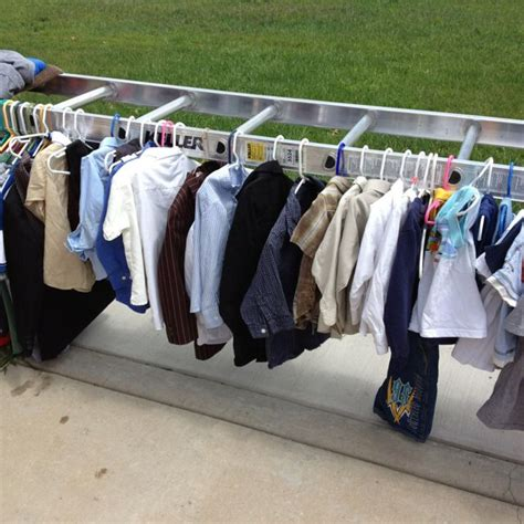 great idea for displaying clothes at a garage sale turn a