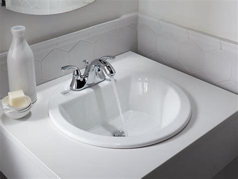 bathroom sink material comparison bryant round drop in sink w 4 inch centers and overflow