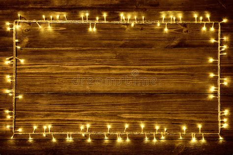 white wall with board and lights stock photo garland lights wood background wooden frame