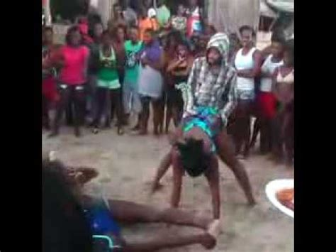 girl dancing on boat with kid man jumps on girl back dangerous dance move dancehall