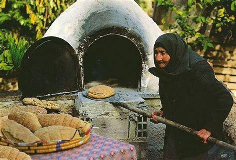 grandmother baking bread   wood oven greecehellas