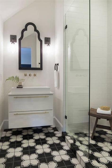 small bathroom  black  white geometric tile floors