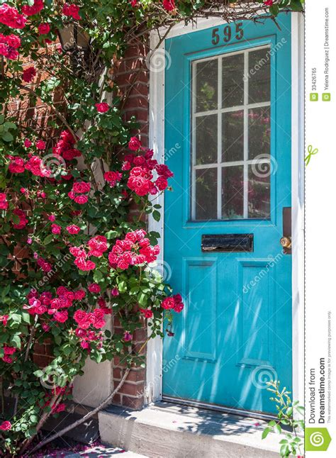colorful door colorful house door surrounded by flowers city s detail