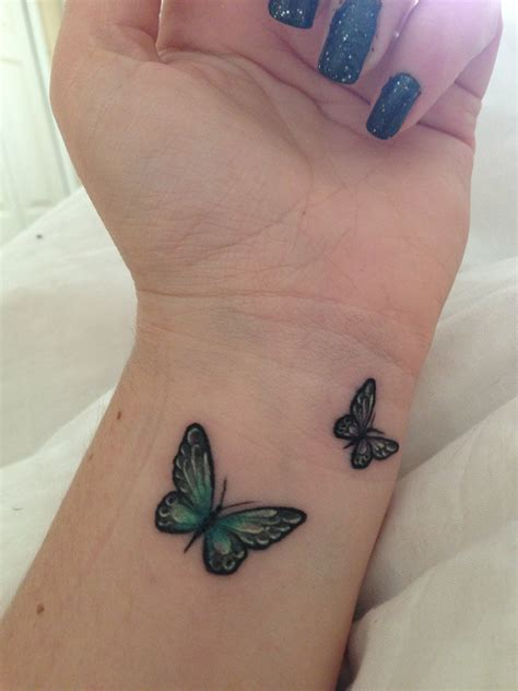 small blue tattoo 25 small tribal tattoos on wrist butterfly wrist