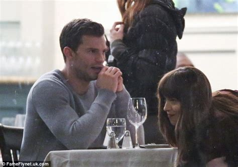 fifty shades darker film budget jamie dornan gives dakota johnson a kiss during encounter