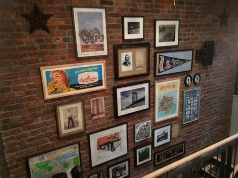 how to hang a picture on a brick wall guide to art placement picture hanging installation