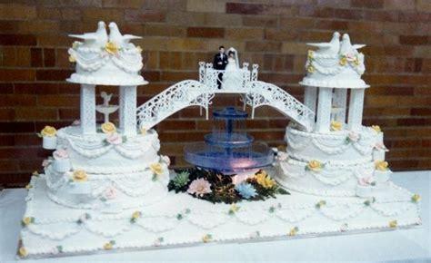 unique double wedding cake connected  bridge  bride