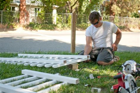 white vinyl fence ta domestic fashionista putting up a picket fence