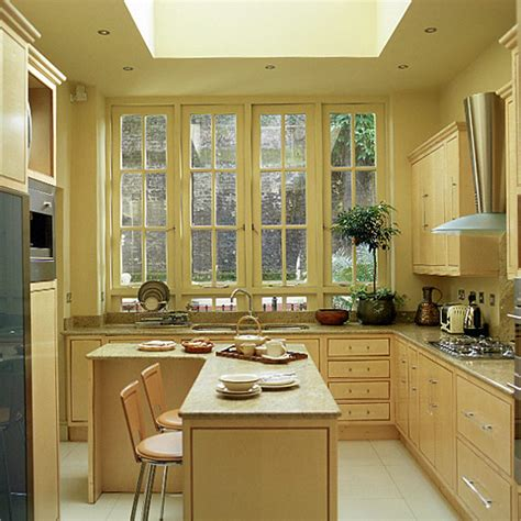 art deco kitchen my style pinterest kitchen with wooden units and breakfast bar ideal home