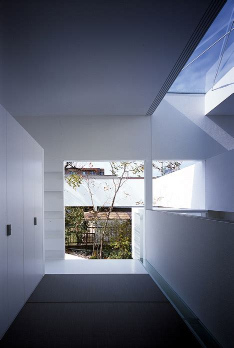 atelier bisque doll by uid architects floating fence surrounds house and doll atelier by