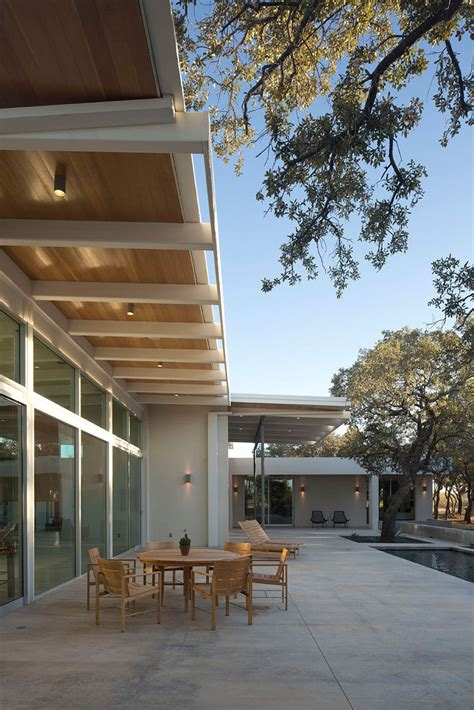 modern house  texas  surrounded  oak trees