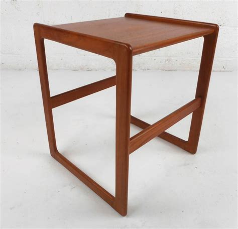 set of mid century modern teak nesting tables at