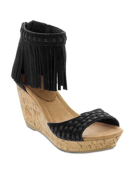 black fringe sandals minnetonka suede fringe wedge sandals in black lyst
