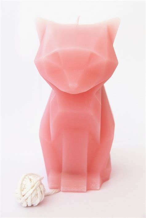 Cool Dresser Designs by Cute Cat Shaped Candle That Transform Into Its Devilish