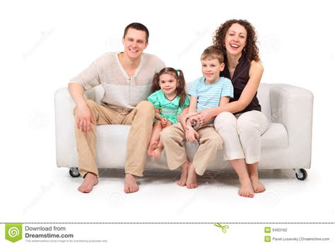 family sofa family sitting on white leather sofa stock photography