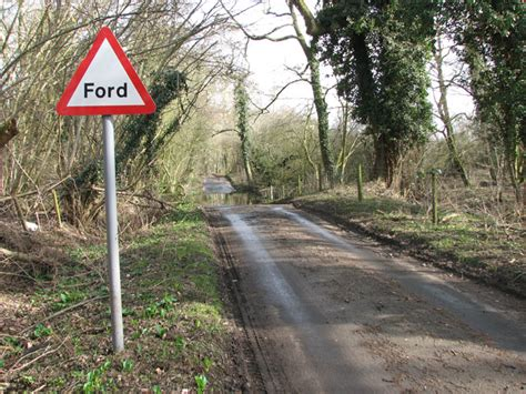 ford on road approaching a ford on bradcar road 169 simak cc by sa