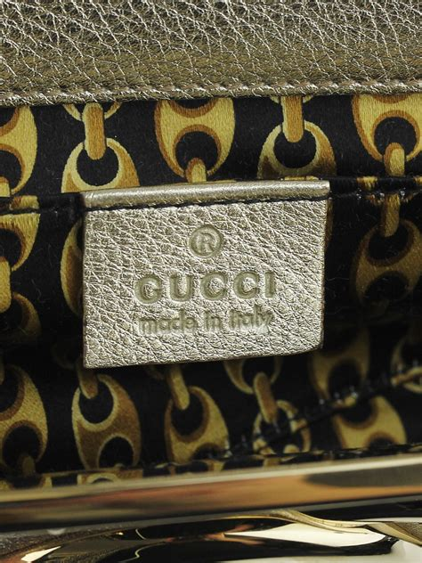 Gucci Starlight Evening Bag by Gucci Gold Leather Interlocking G Starlight Frame Clutch