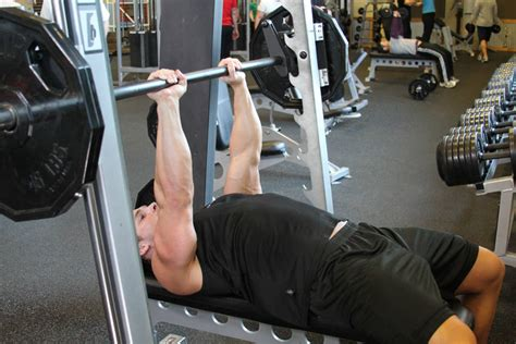 using smith machine for bench press smith machine close grip bench press exercise guide and video