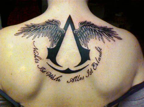 assassin tattoo hours assassins creed tattoo www imgkid com the image kid