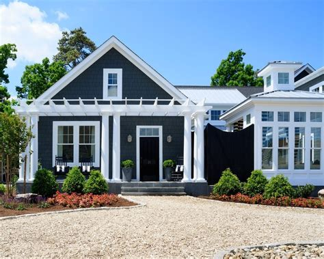 European Style Houses dark blue siding exterior traditional with crushed stone