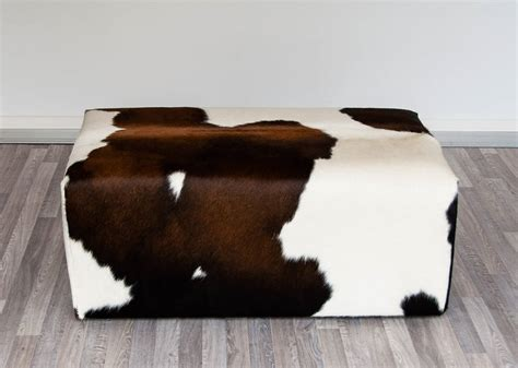 cowhide ottomans chocolate and white cowhide ottoman invisible legs ph 09