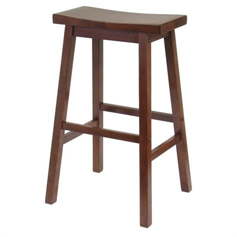 Stool In by 29 Quot Saddle Bar Stool In Antique Walnut 94089