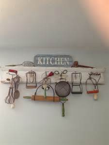 vintage wooden and wire kitchen utensils on display as