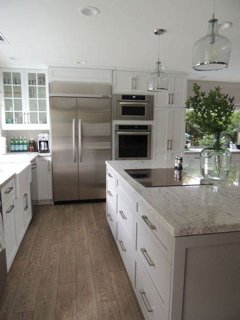 white kitchen  light wood floors  solid stainless