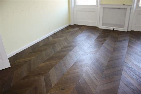 parquet large smoked oak engineered parquet flooring laid in a chevron pattern
