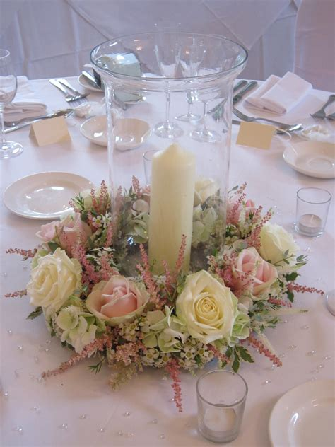 Hurricane Vase Centerpiece by Hurricane Vase With Floral Surround Candle Standing In