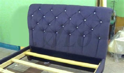 how to put a bed frame together how to reupholster a tufted headboard and install the bed