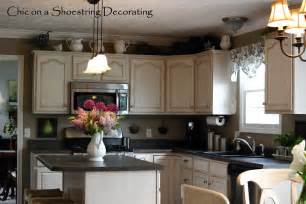 decorating ideas for top of kitchen cabinets chic on a shoestring decorating my spring kitchen