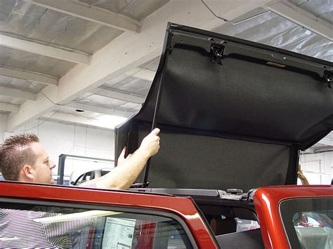 jeep wrangler unlimited soft top installation opening up the sunrider soft top sun roof on a 2007 jeep