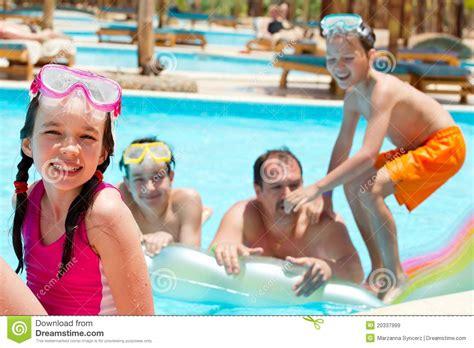 Family Swim Poll happy family in swimming pool stock image image 20337999