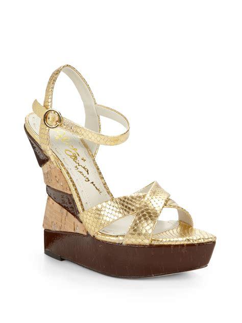 cate metallic viper wedge sandals in gold