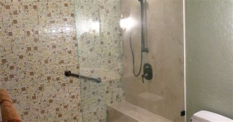 doorless curbless tile shower with river rock floor and curbless doorless shower with a micro versailles glass