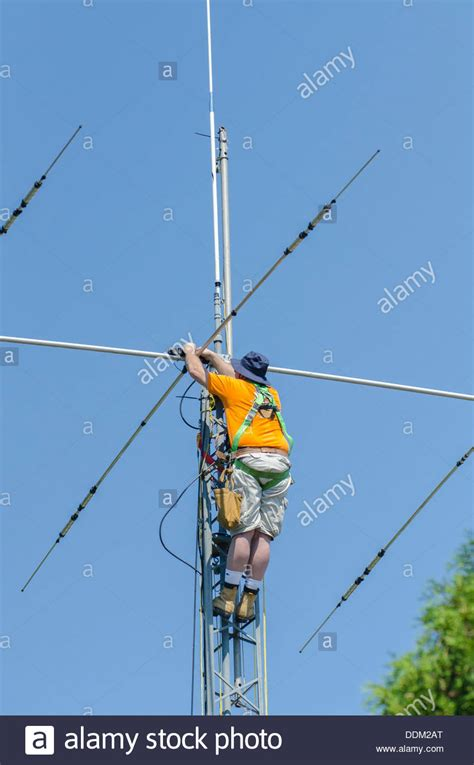 installing a radio antenna at the top of radio tower stock photo royalty free image