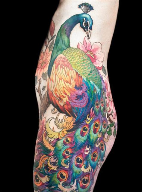 peacock tattoo for men this amazing peacock across the hip and leg can be
