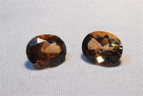 Imperial Chagne Topaz 12 80ct 6 90ct pair of imperial topaz oval faceted cut