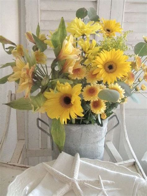 tin buckets for centerpieces gorgeous yellow flower arrangement in a vintage tin